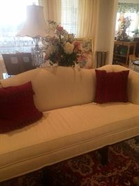 White formal camel back sofa