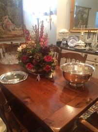 Dining table/6 chairs; silver plate punch bowl; floral arrangement
