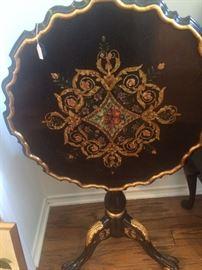 Exceptional tilt table in black & gold