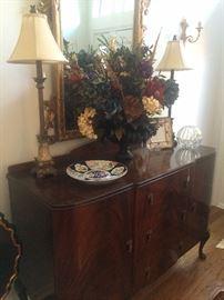 Lovely antique buffet/server; floral arrangement; matching lamps