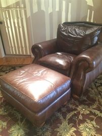 Brown leather club chair and ottaman (rug - not included in the sale)