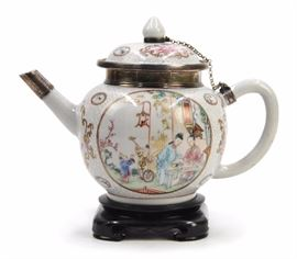 A FAMILLE ROSE ENAMELED PORCELAIN TEAPOT WITH SILVER MOUNTS,QING DYNASTY(1644-1912) Property from an Arizona Collection
