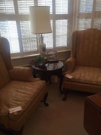Matching wing back chairs, small round side table, one of several lamps