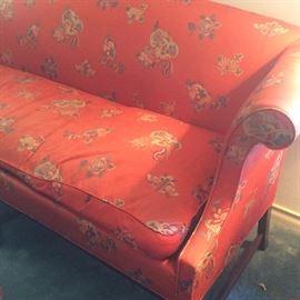 One-cushion orangish-red sofa