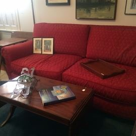 Two cushioned red sofa; small Duncan Phyfe coffee table