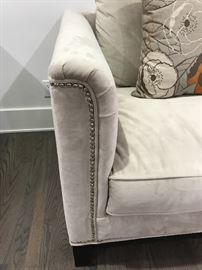 2 Large Off white velour fabric with Silver studs.  31 height (40 with pillows) x 44 high x 40 deep.  Come with grey and orange poppy design pillow $650 each