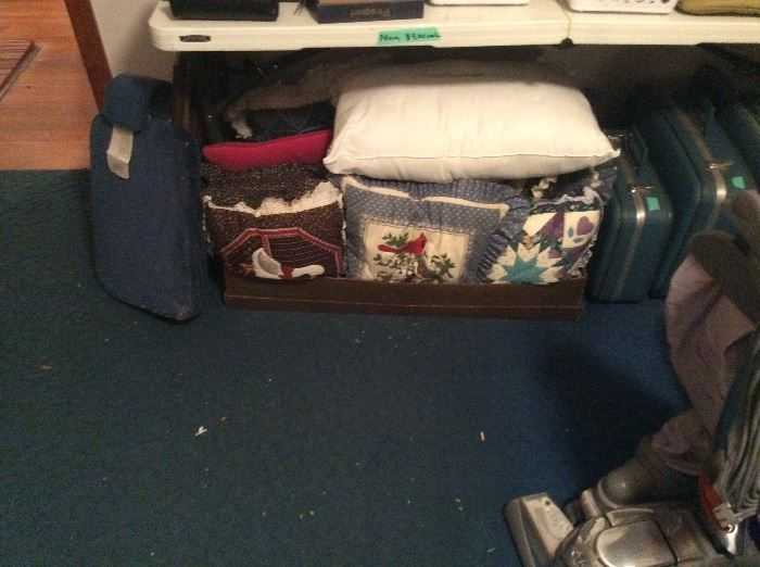 Lots of decorative pillows, vintage suitcases & vacuum with all attachments