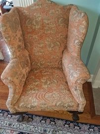 Recently recoveredball and claw foot wing back chair