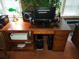 one of three office desks