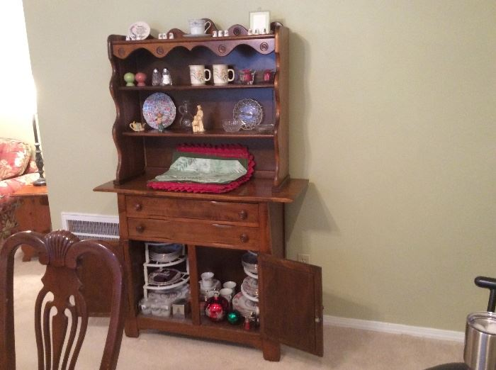 Wooden hutch with collectibles & Christmas items.