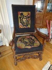 Pair of Carved Antique Throne Chairs with Embellished Needlepoint Tapetries