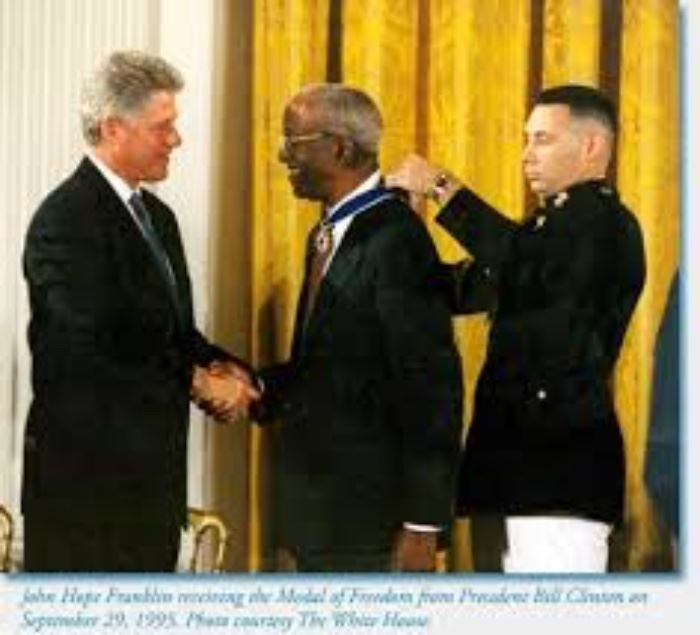 receiving the Presidential Medal of Freedom from President Bill Clinton