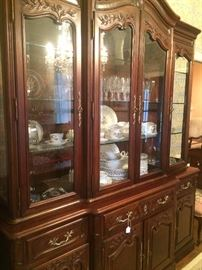 Gorgeous china cabinet has matching dining table and server.