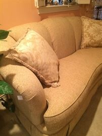 Impressive (like new) curved back, one cushion pale gold sofa and pillows