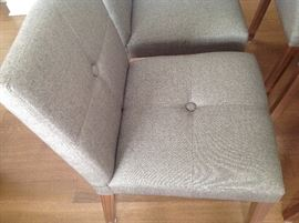 Set of 6 chairs in neutral taupe. Clean condition. Very comfortable. One chair legs needs to be tightened. Can arrange delivery.