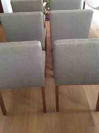 Set of 6 chairs in neutral taupe. Clean condition. Very comfortable.One chair legs needs to be tightened. Can arrange delivery.