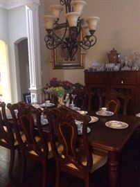 Gorgeous dining table/8 chairs; antique display cabinet