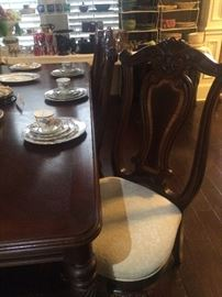 One of the eight dining chairs