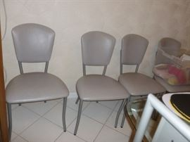 Set of 4 gray leather chairs