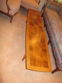 This coffee table is about 70 inches long.