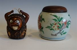 A 19TH CENTURYJAPANESE TOBACCO BOX AND A PORCELAIN BRAZIER POT.