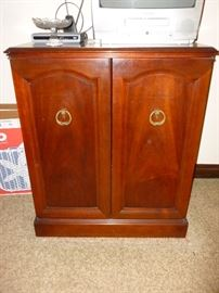 This is a nice vintage stereo cabinet with shelves