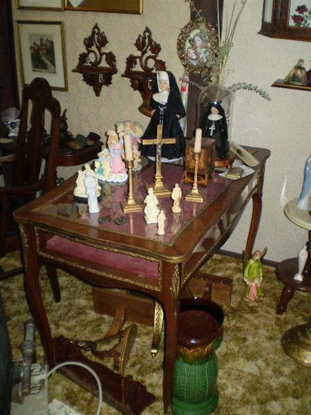 Religious icons, candle holder and pictures