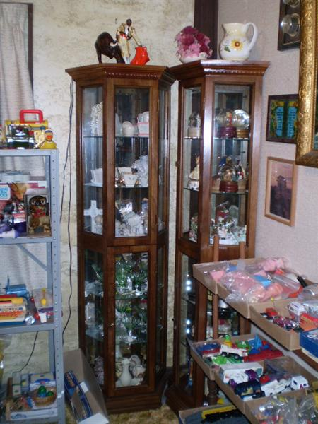 2 Curio cabinets with 3 sides and the back is mirrored.  The 2 could be put back to back to make a hexagonal shape.