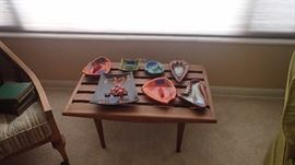 Awesome tea side table with mid century modern style ashtrays. Two great side chairs.