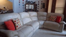Leather sectional with one manual recliner and two electric recliners.