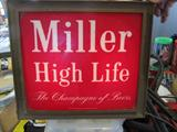 A Miller Beer light up sign that works great! It has been in storage for over 30 years! barn