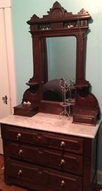 marble-topped dresser