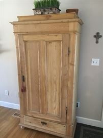 Pine cupboard with interior shelving.