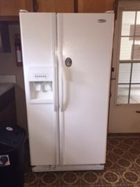 Frigidaire 22 Cu Ft. Refrigerator Side by Side.  New water filter.  The frig has a damaged door tray which is the only thing I can find wrong with the unit.  I think its about 5 years old.  Firm Pricing