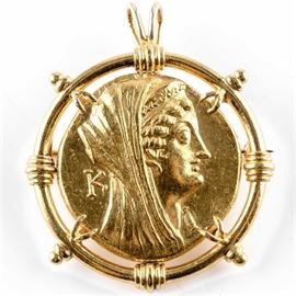 "Ptolemaic Kingdom (c.180-116 BC) Octadrachm Set in a Gold Pendant: A Ptolemaic Kingdom, Arsinöe II, AV Octadrachm (Mnaieion) set in an exquisite gold pendant. Alexandria mint; Struck under Ptolemy VI-VIII (c.180-116 BC). Obverse: Veiled head of Arsinöe II facing right, scepter over far shoulder, ""K"" left of head. Reverse: Double cornucopia with grape cluster to each side, bound with fillet, ""ΑΡΣΙΝΟΗΣ ΦΙΛΑΔΕΛΦΟΥ"". Catalog Reference: Svoronos 1498; SNG Copenhagen 322. Metal content of coin: ≈99% gold. Coin diameter: 27 mm."