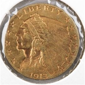 1913 Indian Head $2 1/2 Gold Coin: A 1913 Indian Head $2 1/2 gold coin. Designer: Bela Lyon Pratt. Mintage: 722,000. Metal content: 90% gold, 10% copper. Diameter: 18 mm. Weight: 4.18 grams. Circulated. Good condition.