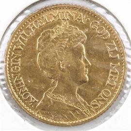 1913 Netherlands Ten Gulden Gold Coin: A 1913 Netherlands ten gulden gold coin. Mintage: 1,133,476. Metal content: 90% gold. Diameter: 22.5 mm. Weight: 6.73 grams. Very good condition.
