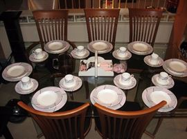 Living room  A. Sibau 6 Dinning room chairs, Large Glass top table,  Beautiful Pink and Grey china set, Pink tableware