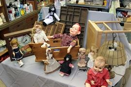 dolls /printers boxes / hand made dolls crib / brass lamps / wicker bench / collectible clocks
