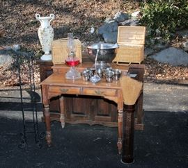 metal plant stands, oil lamps, silver plated punch bowl, wicker picnic baskets, ornamental vases, secretary desk