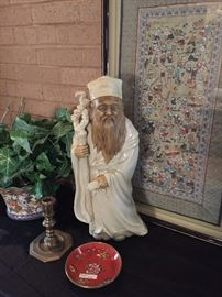 Confucius statue and other Asian touches are evident throughout the house.