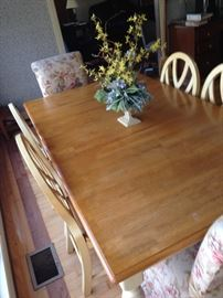 Large and lovely kitchen table with six chairs, two of which are fabric covered. Two matching barstools also.