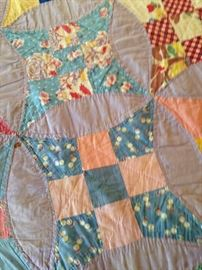 Several quilts and quilt scraps, good cutters, good for crafts