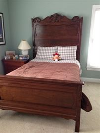 antique bed with carved headboard