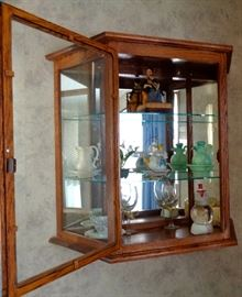 (2) Solid Oak Wall Mounted Curio Cabinet. There are 2 Cabinets For Sale. Precious Moment Figure Collection, Avon Jadite Pitcher