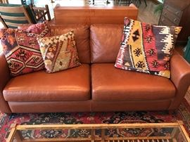 Leather couch with Kilim pillows