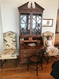 Mahogany Secretary along with Two High Back Chairs, German Doll, and  Side Chair with Bamboo Details.