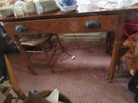 The oak tavern table has one drawer with original hardware. The top of this table is pine.