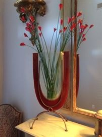 metal stand with glass vase of flowers