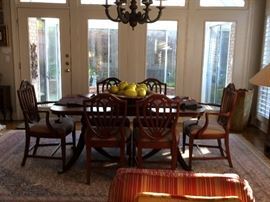 Mahogany dining room table has 3 leaves and is 42 inches wide (with no leaves the leight is 66 inches long ) and 8 shield back chairs , china cabient and buffet   area rug